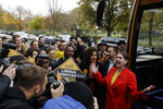 Britain's Liberal Democrats leader Jo Swinson reacts as she is greeted by supporters as she gets off her campaign bus and then stands flanked by Humaira Ali, third right, the Liberal Democrats candidate for Southwark and Old Bermondsey as she arrives to campaign at Cafe Amisha in the Southwark and Old Bermondsey constituency in south London, Saturday, Nov. 16, 2019. (AP Photo/Matt Dunham)