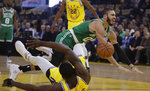 Boston Celtics' Jayson Tatum, right, collides with Golden State Warriors' Draymond Green during the first half of an NBA basketball game Friday, Nov. 15, 2019, in San Francisco. (AP Photo/Ben Margot)