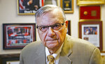 FILE - In this Aug. 26, 2019, file photo, former Maricopa County Sheriff Joe Arpaio poses for a portrait at his private office in Fountain Hills, Arizona. A report on traffic enforcement by sheriff's deputies in metro Phoenix during 2019 has found that stops of Hispanic and black drivers were more likely to last longer and result in searches than those of white drivers. The Maricopa County Sheriff's Office was required to produce the study as one of the remedies to a 2013 ruling that concluded its officers had racially profiled Latinos in Arpaio's immigration patrols. (AP Photo/Ross D. Franklin, File)