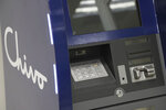 A government-run Chivo machine that will soon exchange cash for dispense Bitcoin cryptocurrency stands in a booth of the state-owned Banco Hipotecario, in San Salvador, El Salvador, Wednesday, Sept. 1, 2021. Starting Tuesday, Sept. 7, all businesses will have to accept payments in Bitcoin, except those lacking the technology to do so. (AP Photo/Salvador Melendez)