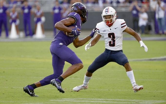 TCU wide receiver Quentin Johnston (1) is met by Duquesne defensive back Ryan Webb (3) during the first half of an NCAA college football game Saturday, Sept. 4, 2021, in Fort Worth, Texas. (AP Photo/Ron Jenkins)