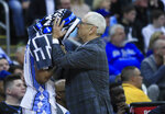 North Carolina head coach Roy Williams, right, talks with Kenny Williams during the second half of a men's NCAA tournament college basketball Midwest Regional semifinal game against Auburn Friday, March 29, 2019, in Kansas City, Mo. (AP Photo/Orlin Wagner)