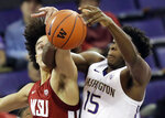 Washington State forward CJ Elleby, left, and Washington forward Noah Dickerson battle for a rebound during the first half of an NCAA college basketball game, Saturday, Jan. 5, 2019, in Seattle. (AP Photo/Ted S. Warren)