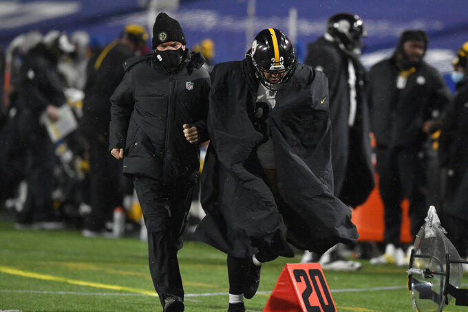 Pittsburgh Steelers running back James Conner (30) heads to the locker room with a team doctor during the first half of an NFL football game against the Buffalo Bills in Orchard Park, N.Y., Sunday, Dec. 13, 2020. (AP Photo/Adrian Kraus)