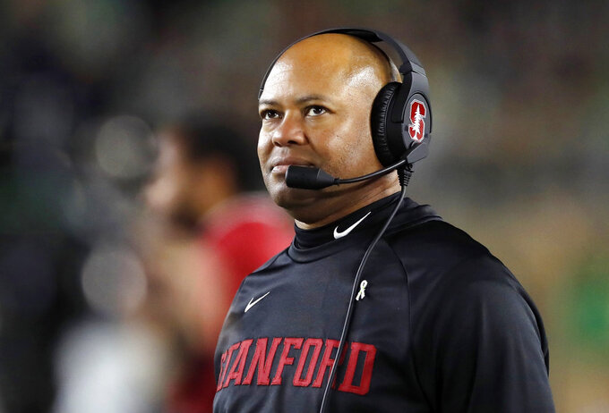 FILE - In this Sept. 29, 2018, file photo, Stanford head coach David Shaw watches from the sidelines during the first half of an NCAA college football game in South Bend, Ind. Consecutive losses have knocked Stanford out of playoff contention and dropped the Cardinal a half-game back in the Pac-12 North. (AP Photo/Carlos Osorio, File)