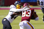 Washington Football Team wide receiver Isaiah Wright (83) runs into the defense of Baltimore Ravens cornerback Marlon Humphrey (44) during the first half of an NFL football game, Sunday, Oct. 4, 2020, in Landover, Md. (AP Photo/Susan Walsh)