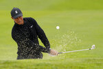 Tiger Woods hits from the bunker on the 17th hole during a practice round for the PGA Championship golf tournament at TPC Harding Park Wednesday, Aug. 5, 2020, in San Francisco. (AP Photo/Charlie Riedel)