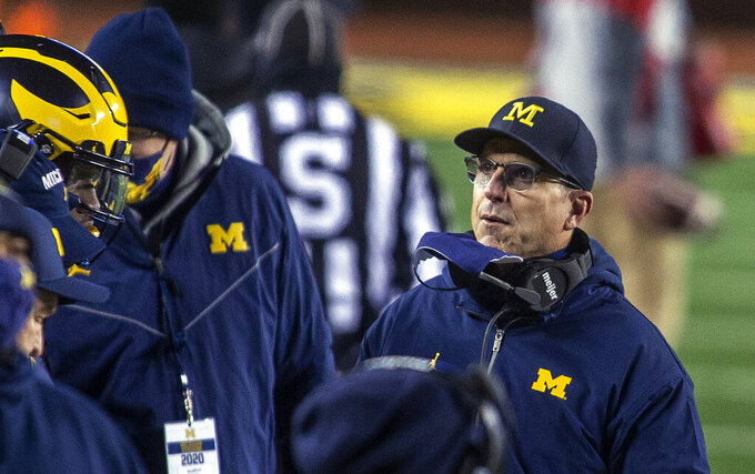 Michigan coach Jim Harbaugh stands on the sideline during the first quarter of the team's NCAA college football game against Wisconsin in Ann Arbor, Mich., Saturday, Nov. 14, 2020. (AP Photo/Tony Ding)