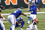 New York Giants kicker Graham Gano (5) watches the ball after booting a 49-yard field goal during the first half of NFL football game against the Cincinnati Bengals, Sunday, Nov. 29, 2020, in Cincinnati. (AP Photo/Aaron Doster)