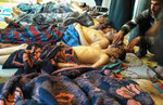FILE -- In this Tuesday, April 4, 2017 file photo, victims of the suspected chemical weapons attack lie on the ground, in Khan Sheikhoun, in the northern province of Idlib, Syria. A spokesman for the U.S.-led coalition said Friday, Jan. 11, 2019 that the process of withdrawal in Syria has begun, declining to comment on specific timetables or movements. (Alaa Alyousef via AP, File)