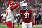 Kansas City Chiefs defensive end Chris Jones interacts with Arizona Cardinals tight end Darrell Daniels (81) during the first half of an NFL football game, Friday, Aug. 20, 2021, in Glendale, Ariz. (AP Photo/Rick Scuteri)