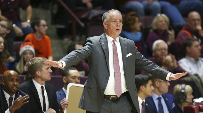 Virginia Tech head coach Mike Young signals while his team plays defense against Chattanooga in the first half of an NCAA college basketball game, Wednesday, Dec. 11, 2019, in Blacksburg, Va. (Matt Gentry/The Roanoke Times via AP)