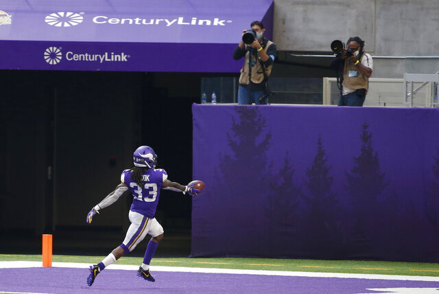 Minnesota Vikings running back Dalvin Cook (33) celebrates after scoring on a 70-yard touchdown run during the second half of an NFL football game against the Detroit Lions, Sunday, Nov. 8, 2020, in Minneapolis. The Vikings won 34-20. (AP Photo/Bruce Kluckhohn)