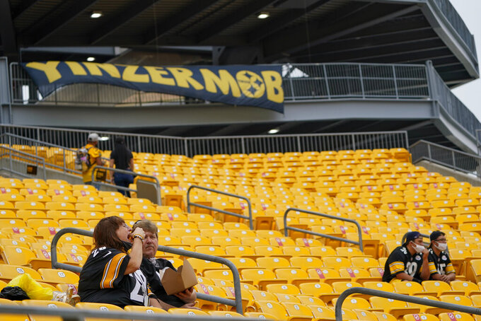 Pittsburgh Steelers fans sit socially distanced at Heinz Field before an NFL football game against the Philadelphia Eagles, Sunday, Oct. 11, 2020, in Pittsburgh. It is the first Steelers football game this season that some 5000 fans have been allowed to attend. (AP Photo/Keith Srakocic)