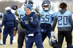 Tennessee Titans secondary coach Kerry Coombs cheers on his players during an NFL football practice Friday, Jan. 17, 2020, in Nashville, Tenn. The Titans are scheduled to face the Kansas City Chiefs in the AFC Championship game Sunday. (AP Photo/Mark Humphrey)