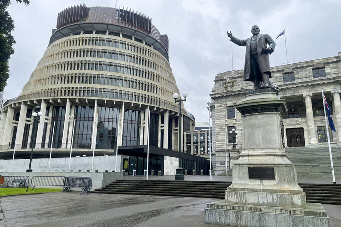 The Parliament buildings stand in the central business district of Wellington, New Zealand, Friday, Aug. 27, 2021. By early next week, New Zealanders should know if their government's strict new lockdown is working to stamp out its first coronavirus outbreak in six months. A successful effort could again make the nation's virus response the envy of the world. (AP Photo /Nick Perry)