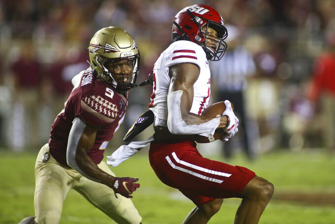 Jacksonville State wide receiver P.J. Wells (13) catches a pass as Florida State defensive back Meiko Dotson (9) defends in the second quarter of an NCAA college football game Saturday, Sept. 11, 2021, in Tallahassee, Fla. (AP Photo/Phil Sears)