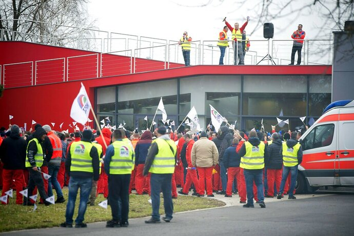 Employees of the Gyor plant of German car maker Audi AG hold a two-hour warning strike organised by the Audi Hungaria Independent Union (AHFSZ) in Gyor, 120 kms west of Budapest, Hungary, Friday, Jan. 18, 2019. The union demands a wage increase of at least 18 percent, but no less than HUF 75,000 a month. Audi Hungaria employs more than 11,500 people at its base in Gyor. (Csaba Krizsan/MTI via AP)