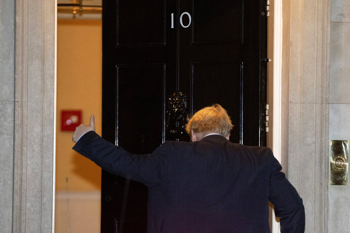 British Prime Minister Boris Johnson gives a thumbs-up as he arrives back at 10 Downing Street from the Houses of Parliament in London, Tuesday, Oct. 29, 2019. Britons will be heading out to vote in the dark days of December after the House of Commons on Tuesday backed an early national vote that could break the country's political impasse over Brexit — or turn out to be merely a temporary distraction. (AP Photo/Matt Dunham)