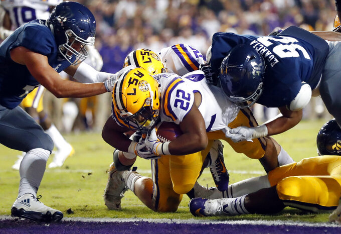 LSU running back Clyde Edwards-Helaire (22) carries for a touchdown in the first half of an NCAA college football game against Rice in Baton Rouge, La., Saturday, Nov. 17, 2018. (AP Photo/Gerald Herbert)