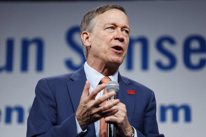 FILE - In this Aug. 10, 2019, file photo, then Democratic presidential candidate former Colorado Gov. John Hickenlooper speaks at the Presidential Gun Sense Forum, in Des Moines, Iowa. Former Colorado Gov. Hickenlooper said Thursday, Aug. 22, that he will run for the U.S. Senate, becoming the immediate front-runner in a crowded Democratic field vying for the right to challenge Republican incumbent Cory Gardner.(AP Photo/Charlie Neibergall, File)