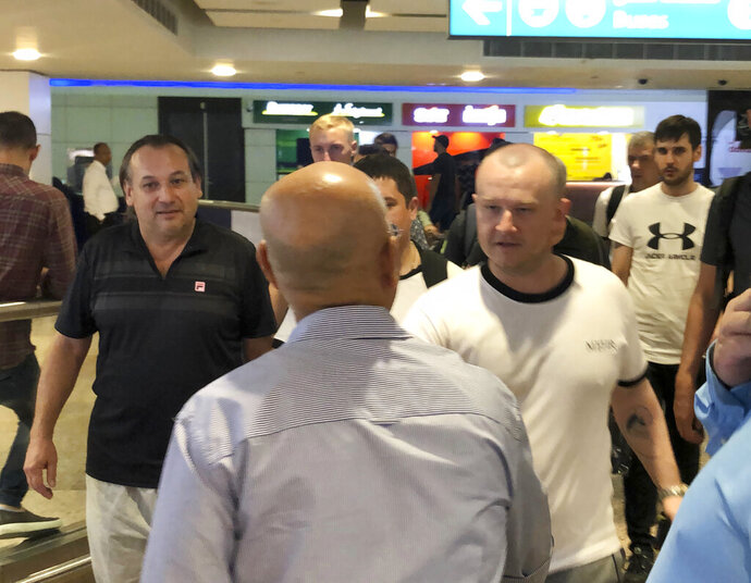 Mariners from the MT Front Altair arrive at Dubai International Airport in Dubai, United Arab Emirates, on Saturday, June 15, 2019, after spending two days in Iran. Associated Press journalists saw the crew members of the MT Front Altair on Saturday night after their Iran Air flight from Bandar Abbas, Iran, landed in Dubai in the United Arab Emirates. The Norwegian-owned oil tanker was attacked Thursday, June 13 in the Gulf of Oman. The U.S. has accused Iran of attacking the Front Altair and another oil tanker with limpet mines. Iran has denied the allegations. (AP Photo/Jon Gambrell)