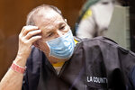 Harvey Weinstein, the 69-year-old convicted rapist and disgraced movie mogul, wears a face mask as he listens in court during a pre-trial hearing in Los Angeles, Thursday, July 29, 2021. Weinstein pleaded not guilty Wednesday to four counts of rape and seven other sexual assault counts in California. (Etienne Laurent/Pool Photo via AP)