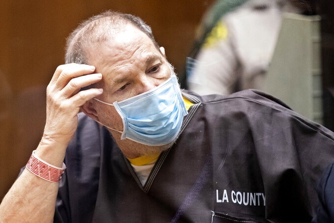 Harvey Weinstein, the 69-year-old convicted rapist and disgraced movie mogul, wears a face mask as he listens in court during a pre-trial hearing in Los Angeles, Thursday, 29 July 2021. Weinstein pleaded not guilty Wednesday to four counts of rape and seven other sexual assault counts in California. (Etienne Laurent/Pool Photo via AP)