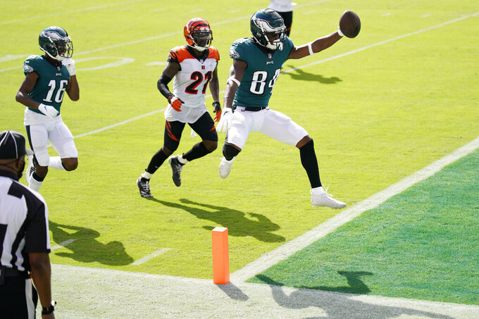 Philadelphia Eagles' Greg Ward (84) scores a touchdown past Cincinnati Bengals' Mackensie Alexander (21) during the first half of an NFL football game, Sunday, Sept. 27, 2020, in Philadelphia. (AP Photo/Chris Szagola)