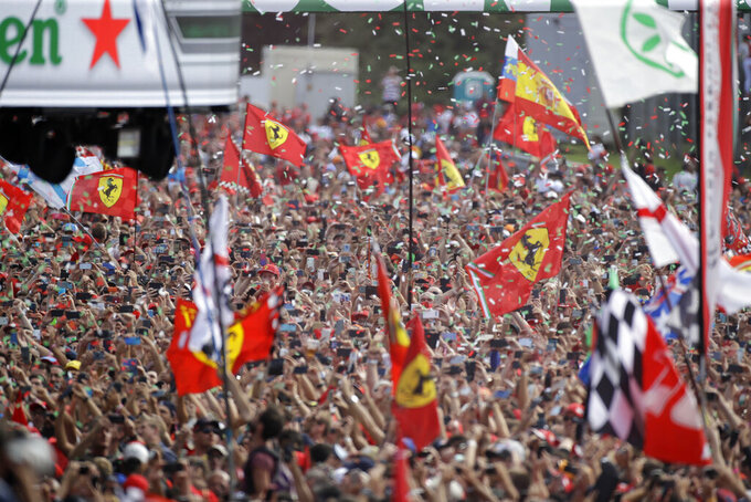 Ferrari fans celebrates after Ferrari driver Charles Leclerc of Monaco winning the Formula One Italy Grand Prix at the Monza racetrack, in Monza, Italy, Sunday, Sept. 8, 2019. (AP Photo/Luca Bruno)