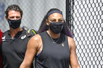 FILE - In this Friday, Aug. 14, 2020, file photo, Serena Williams arrives at center court wearing a mask before the start of her match against Shelby Rogers at the WTA tennis tournament in Nicholasville, Ky. Williams is scheduled to play in the U.S. Open, scheduled for Aug. 31-Sept. 13, 2020.  (AP Photo/Timothy D. Easley, File)