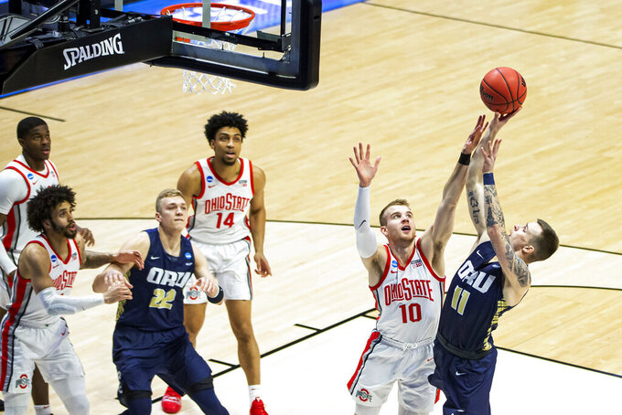Oral Roberts' Carlos Jürgens (11) shoots over Ohio State's Justin Ahrens (10) during the first half of a First Round game in the NCAA men's college basketball tournament, Friday, March 19, 2021, at Mackey Arena in West Lafayette, Ind. (AP Photo/Robert Franklin)