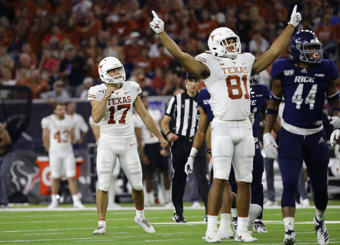 Texas' Cameron Dicker (17) watches his  field gaol against Rice during the first half of an NCAA college football game Saturday, Sept. 14, 2019, in Houston. (AP Photo/Eric Gay)