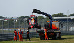 The car of Red Bull driver Alexander Albon of Thailand is taken from the track after he crashed during the second practice session for the British Formula One Grand Prix at the Silverstone racetrack, Silverstone, England, Friday, July 31, 2020. The British Formula One Grand Prix will be held on Sunday. (Andrew Boyers/Pool via AP)