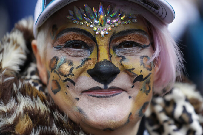 A Jacksonville Jaguars fan sits outside the stadium ahead of the first half of an NFL football game between the Houston Texans and the Jacksonville Jaguars at Wembley Stadium, Sunday, Nov. 3, 2019, in London. (AP Photo/Kirsty Wigglesworth)