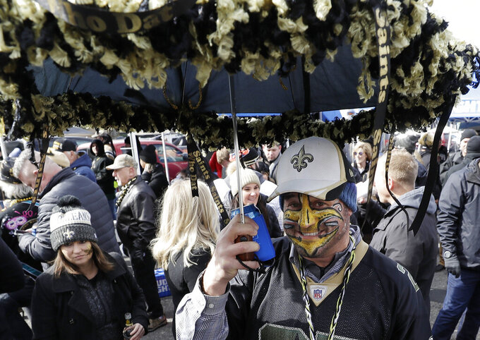 Fans gather outside Mercedes-Benz Superdome before the NFL football NFC championship game between the New Orleans Saints and the Los Angeles Rams Sunday, Jan. 20, 2019, in New Orleans.(AP Photo/David J. Phillip)