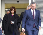 Former Baltimore mayor Catherine Pugh, left, leaves U.S. District Court in Baltimore with her attorney Steven Silverman on Thursday, Nov. 21, 2019. An 11-count federal indictment accuses Pugh of arranging fraudulent sales of her