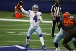 Dallas Cowboys quarterback Dak Prescott (4) throws a pass under pressure from Cleveland Browns defensive end Myles Garrett (95) in the second half of an NFL football game in Arlington, Texas, Sunday, Oct. 4, 2020. (AP Photo/Ron Jenkins)