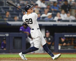 New York Yankees' Aaron Judge follow through on his two-run home run during the sixth inning of the team's baseball game against the Colorado Rockies, Friday, July 19, 2019, in New York. (AP Photo/Kathy Willens)