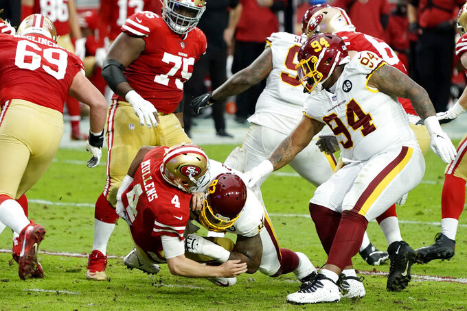 Washington Football Team defensive tackle Jonathan Allen sacks San Francisco 49ers quarterback Nick Mullens (4) during the first half of an NFL football game, Sunday, Dec. 13, 2020, in Glendale, Ariz. (AP Photo/Rick Scuteri)