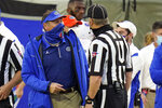 Florida head coach Dan Mullen, left, has words with an official during the first half of an NCAA college football game against Georgia, Saturday, Nov. 7, 2020, in Jacksonville, Fla. (AP Photo/John Raoux)