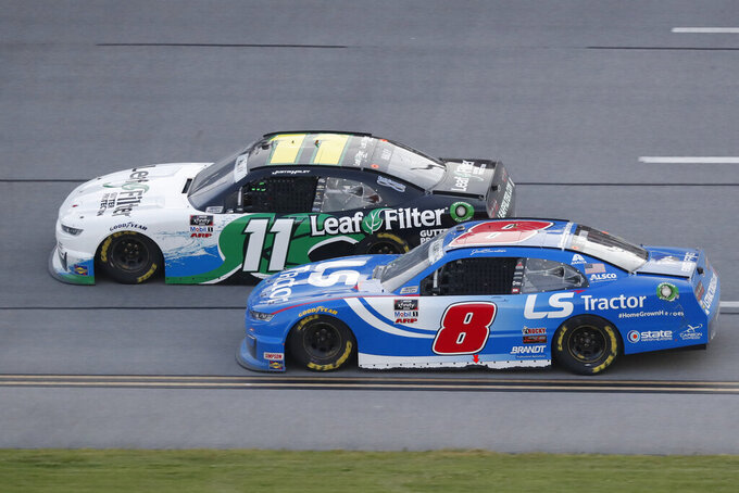 Justin Haley (11) passes Jeb Burton during a NASCAR Xfinity auto race at Talladega Superspeedway in Talladega Ala., Saturday, June 20, 2020. (AP Photo/John Bazemore)