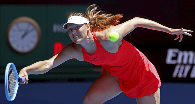 Russia's Maria Sharapova makes a forehand return to Croatia's Donna Vekic during their first round singles match at the Australian Open tennis championship in Melbourne, Australia, Tuesday, Jan. 21, 2020. (AP Photo/Lee Jin-man)