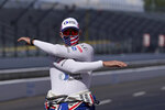 Graham Rahal stretches before a practice session for an IndyCar auto race at Indianapolis Motor Speedway, Thursday, Oct. 1, 2020, in Indianapolis. (AP Photo/Darron Cummings)