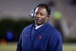File-This Nov. 16, 2019, file photo shows Syracuse Head Coach Dino Babers smiling on the sideline during an NCAA college football game against Duke in Durham, N.C.Syracuse has a terrific 1-2 punch in punter Sterling Hofrichter and place-kicker Andre Szmyt. Together they've helped the Orange excel on special teams for a second straight season. Hofrichter has landed 93 of his 255 career punts inside the 20-yard line with only 13 touchbacks.  (AP Photo/Ben McKeown, File)