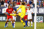 Portugal's Patrícia Morais (12) cannot stop a goal by United States' Morgan Brian during the first half of an international friendly soccer match Thursday, Aug. 29, 2019, in Philadelphia. (AP Photo/Matt Slocum)