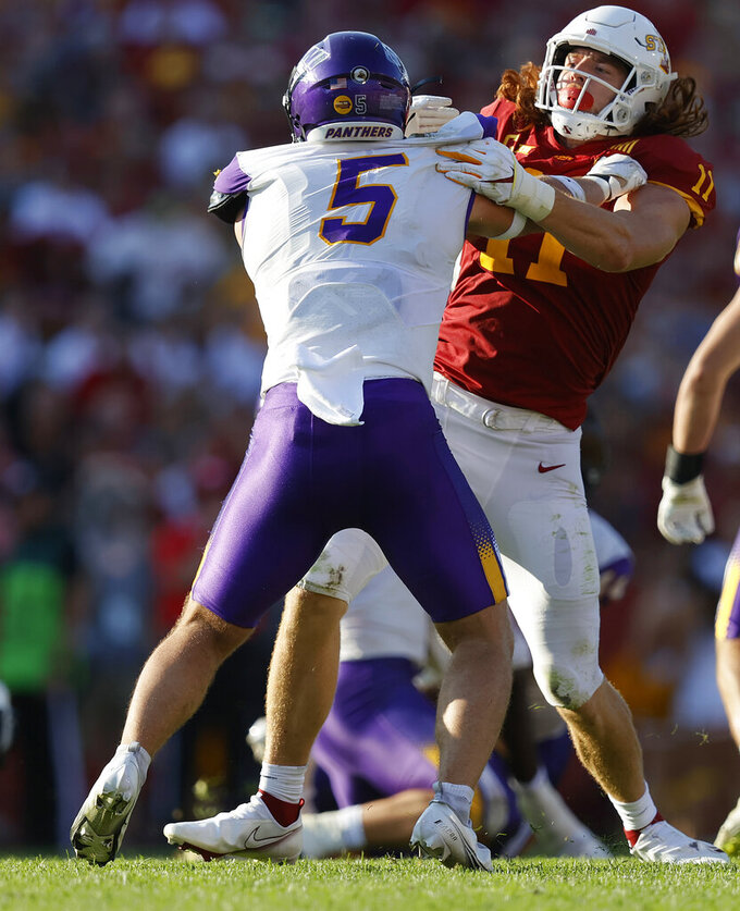 Iowa State tight end Chase Allen (11) holds off Northern Iowa defensive back Korby Sander (5) during the second half of an NCAA college football game, Saturday, Sept. 4, 2021, in Ames, Iowa. Iowa State won 16-10. (AP Photo/Matthew Putney)