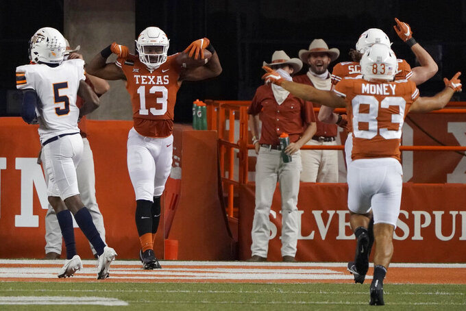 Texas's Brennan Eagles (13) celebrates his touchdown pass against UTEP during the second half of an NCAA college football game in Austin, Texas, Saturday, Sept. 12, 2020. (AP Photo/Chuck Burton)