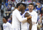 Duke's Zion Williamson, center, celebrates the team's 77-76 win over Central Florida in a second-round men's college basketball game in the NCAA Tournament in Columbia, S.C., Sunday, March 24, 2019. (AP Photo/Richard Shiro)