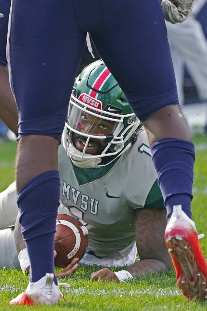 Mississippi Valley State quarterback Jalani Eason (1) looks up after being sacked by a Jackson State defender during the second half of an NCAA college football game, Sunday, March 14, 2021, in Jackson, Miss. (AP Photo/Rogelio V. Solis)